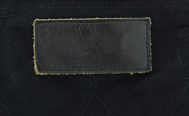 blank black leather label isolated