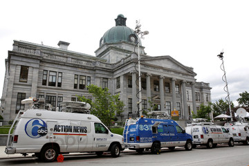 Television news vans are parked in front of the Montgomery County Courthouse, during the third day of Bill Cosby's sexual assault trial at the Montgomery County Courthouse in Norristown