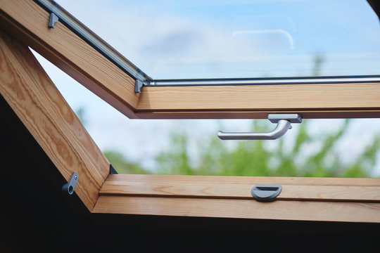 Open wooden window with silver handle