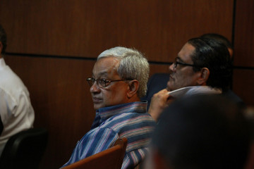 Maximo de Oleo reacts during a hearing in Santa Domingo
