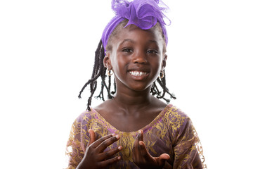 Portrait of a happy African  little girl  in purple costume.Isolated