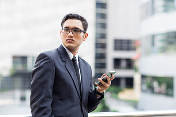 Young asian businessman outdoors