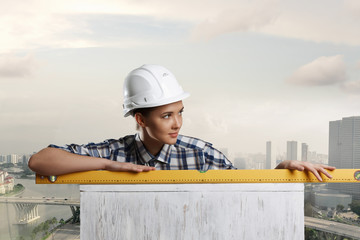 Builder woman taking measures. Mixed media