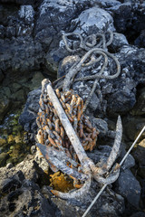 An anchor of a fishing boat at Damouchari Harbour, Pelion peninsula, Greece.