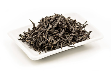 zheng shan xiao zhong black tea leaves on the rectangular white plate on the white background
