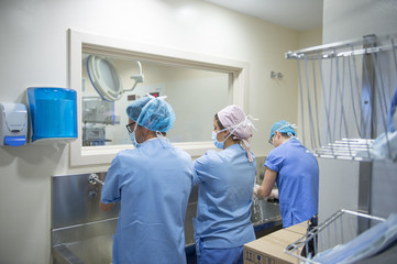 Doctors washing hands before operation