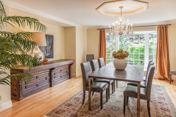 Elegant dining room with wood table and chandelier