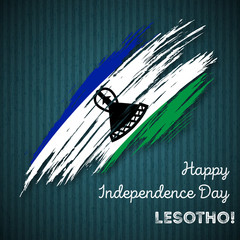 Lesotho Independence Day Patriotic Design. Expressive Brush Stroke in National Flag Colors on dark striped background. Happy Independence Day Lesotho Vector Greeting Card.
