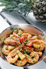 stir fry prawns in spicy asian pineapple and herbs sauce