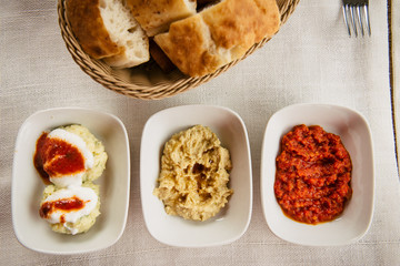 meze small dishes on the table: hummus, Antep Ezmesi