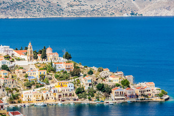 Cityscape of the capital city of a picturesque, romantic Symi island, Greece