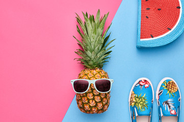 Fashion Hipster Pineapple Fruit. Bright Summer Color, Accessories. Tropical pineapple with Sunglasses, Stylish Glamour Handbag Creative Art concept. Minimal style. Pink blue summer party background Wall mural