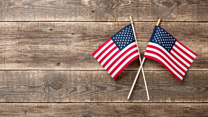 USA flags on wooden background