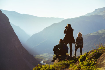 Group of three friends in mountains range