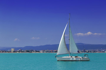 Sailing yacht in to the sea in summer