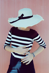 Beautiful old fashioned vintage hipster and retrò girl with straw hat