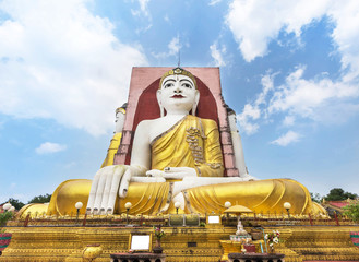 big four Buddha statues or  Kyaik Pun pagoda in Bago , Myanmar on blue sky background