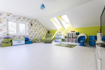 Big and bright child room at the attic