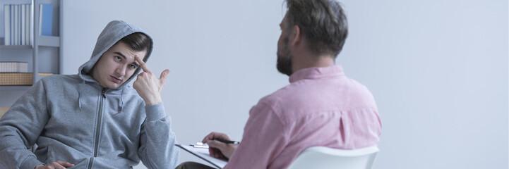 Teenager talkig with psychologist