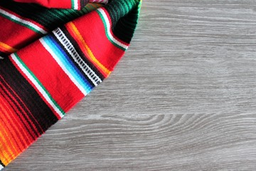 mexican poncho blanket serape background Mexican cinco de mayo fiesta wooden copy space stock, photo, photograph, picture, image,