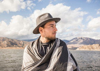 Man wrapped in blanket at Lake Isabella, California, USA
