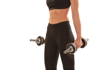 athletic female body with dumbbells