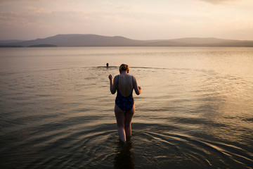 Woman walking in shallow water, Nizny Tagil, Russia