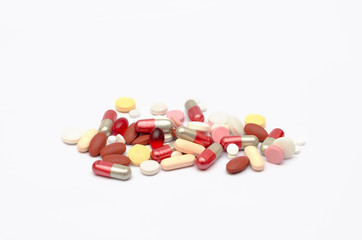 many drug with pills, capsules and tablet medicine on white background.