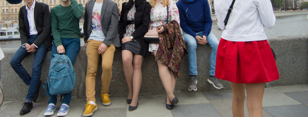 A group of students sitting and resting on the embankment