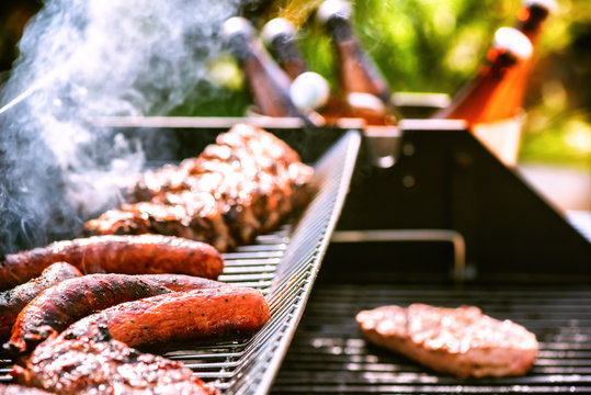 Meat cooking on barbecue grill for summer outdoor party