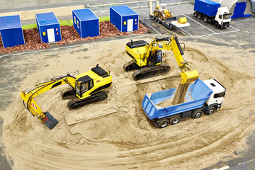 Work excavators to load sand in truck. Miniature model