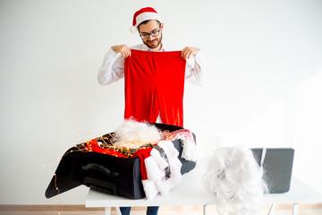 Guy dressing up as Santa Claus