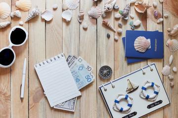 Striped espadrilles, money, compass, passports and marine decorations