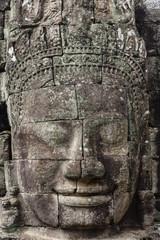 Buddha face carved in stone at the Bayon Temple, Angkor Thom, Angkor, Cambodia.