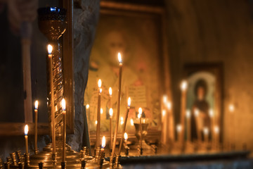 Icons and burning candles in the church