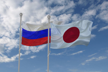 Russia and Japan flag waving in the sky