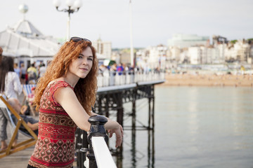 Young red hair woman on vacation in a touristic english city