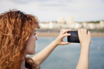 Woman taking a picture with a smart phone