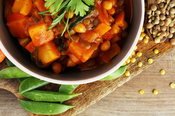 Lentil with carrot and potato in a grey bowl. Healthy lifestyle. Diet menu