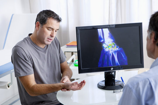 Male patient consulting for wrist pain