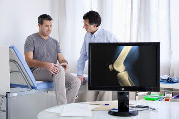 Male patient consulting for knee pain