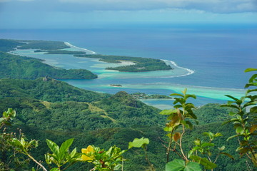 Huahine island coastal landscape, forest with the lagoon and islets seen from the mount Pohue Rahi, south Pacific ocean, Leeward islands, French Polynesia