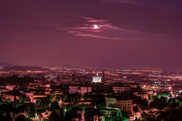 View at Old Town Citta Alta of Bergamo from San Vigilio Hill. Bergamo, Italy. Night view.