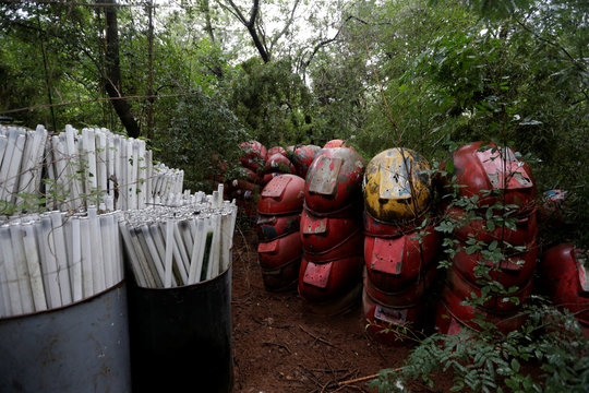 Used fluorescent light tubes and discarded public phone booths are seen at the ecological park Ita Enramada whose caretakers collect electronic waste, light tubes and batteries for their further recycling, in Asuncion