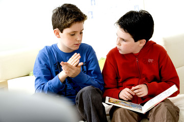 Models Do not use for HIV A young hearing-impaired boy and his brother using the French sign language with the aid of a book The French sign language uses signs to designate words but also dactylology (each letter of the alphabet is represented by a defined position of the fingers then enabling to spell a word) and the lip reading The young boy designates the word \because\