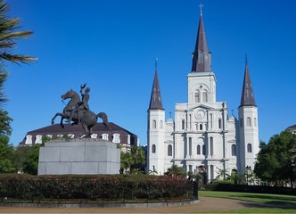 The St Louis Cathedral and statue of Andrew Jackson on horse in Jackson Square of the French Quarter in New Orleans, Louisiana