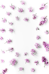 Woman office desk with lilac blossom design white background top view mockup