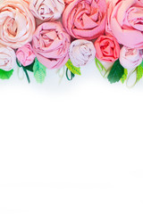 Rose of pink fabric. White background. Flowers of the cotton fabric.