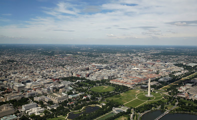 This aerial picture shows the Washington Monument standing on the National Mall and the White House at far left in Washington