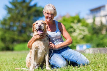mature woman with a dog outdoor
